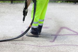 Vandalism Graffiti Cleanup - Removal by Dustless Blasting Machine